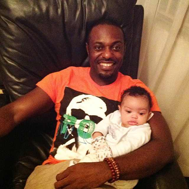 Jim Iyke cuddles his son