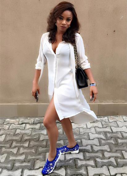Toke Makinwa in a white shirtdress