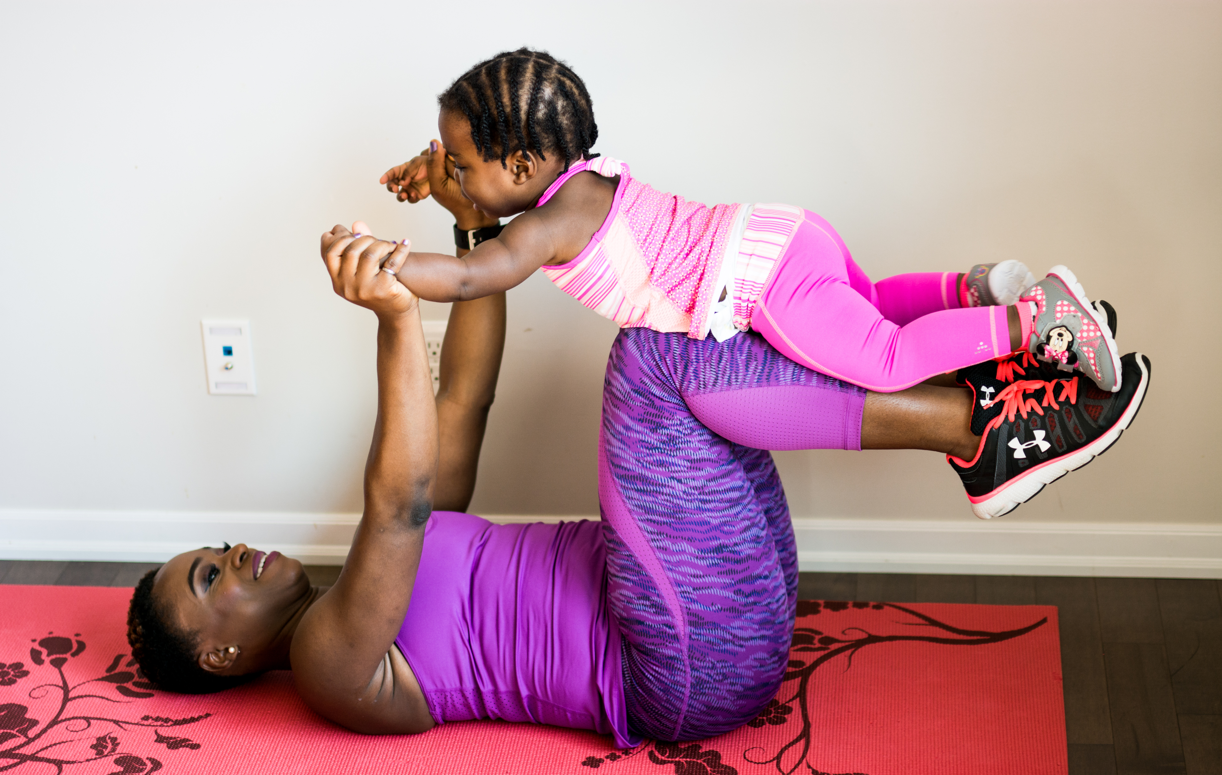 Mother and child doing some routine floor exercises