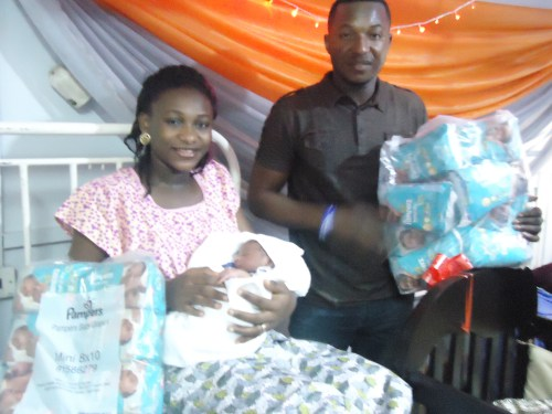 Mr and Mrs Olumide Akande with their baby